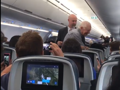 Jimmy Carter shakes hands on plane