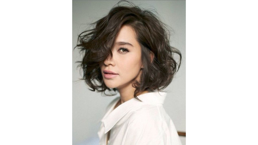 Choppy Bang Hairstyle. Asymmetrical Bob. Messy Curly Cut